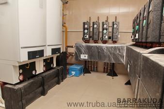 Дом 800 кв.м. Экономичная система отопления на двух топовых конденсационных котлах BUDERUS GB162 по 80 кВт  и дублирующем твердотопливном котле — Барракуда - Современные системы отопления