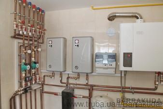 Система отопления на эффективном конденсационном котле BUDERUS  60 кВт (Германия) и дублирующих электрокотлах, с погодозависимым управлением. — Барракуда - Современные системы отопления